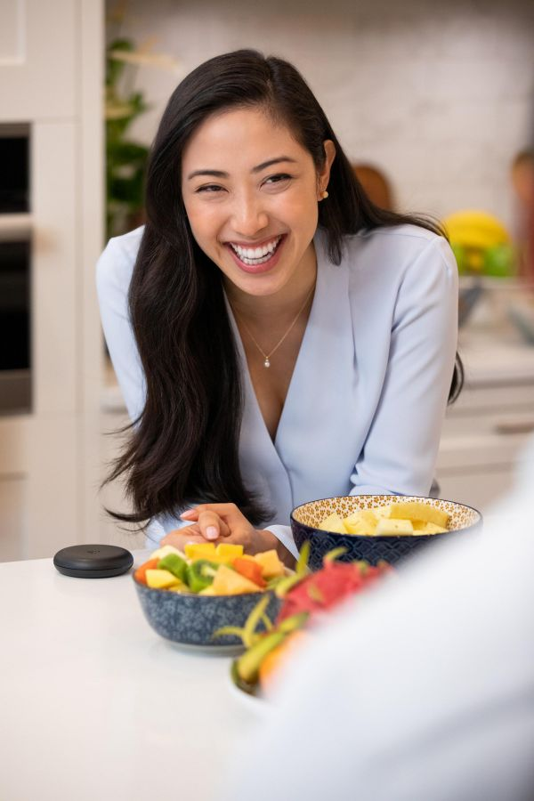 Woman in the kitchen wearing her invisible braces