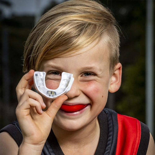 kid with a custom mouthguard on the Gold Coast